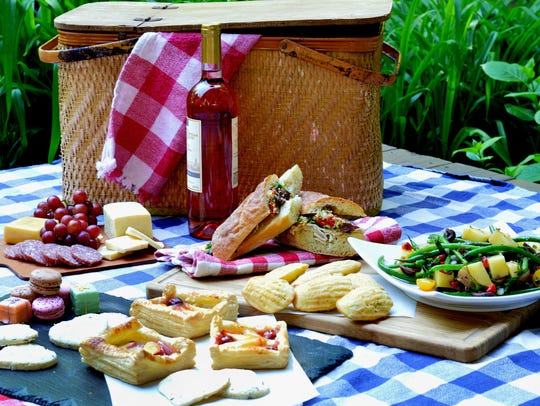 A picnic basket filled with French foods--and wine,