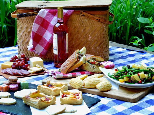 A picnic basket filled with French foods--and wine, of course--is the perfect way to celebrate Bastille Day.