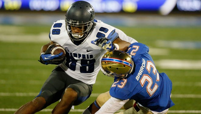 Memphis wide receiver Phil Mayhue (89) is tackled by Tulsa cornerback Will Barrow (23) during an NCAA college football game between Memphis and Tulsa in Tulsa, Okla., Friday.