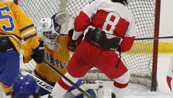 North Rockland's Luke MacMillan shoots on Mahopac goalie