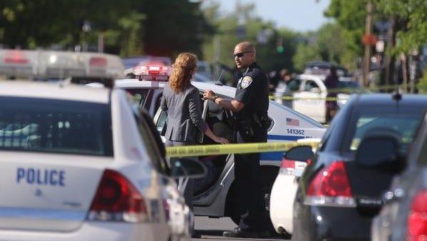 Police at the scene of stabbing in city.