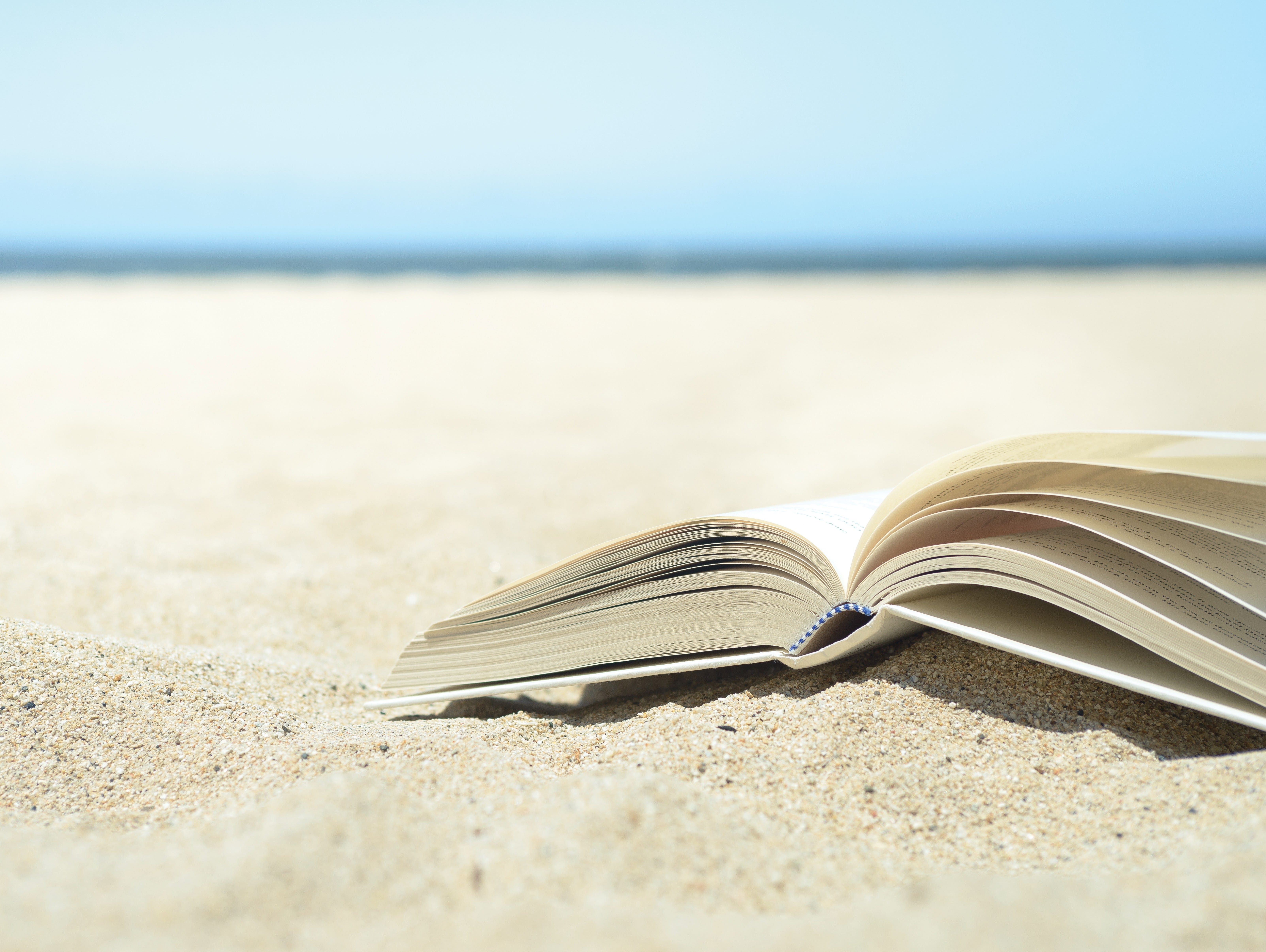You're all set for the beach. Sunscreen? Check. Shades? Check. Folding chairs and umbrella? Check and check. Now, don't forget to take a great book.