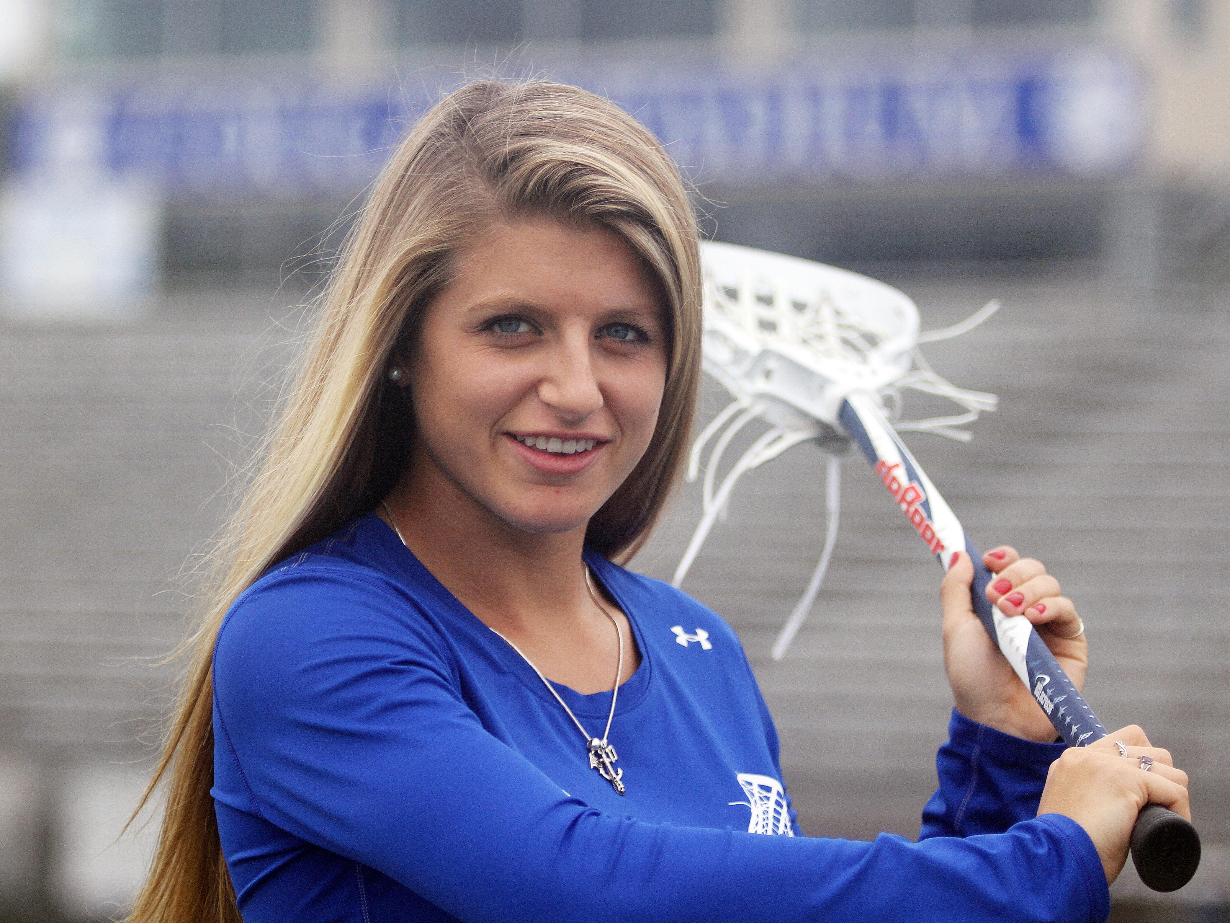 Olivia Ferrucci,18, is a star middle fielder on the Barron Collier High School girls' lacrosse team, A senior, she is headed to the UnIversity of North Carolina and has been named to the 25-player training pool with the U-19 women's national team.