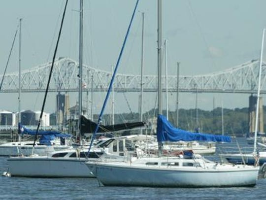 The Outerbridge Crossing in the background of boats