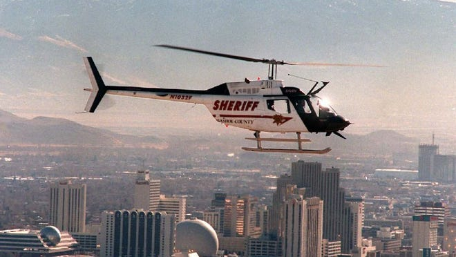 One of Washoe County Sheriff's Office's helicopters, Raven, hovers above north Reno in 1999.