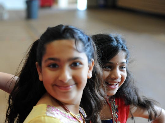 Dressed in traditional Indian wear, Nirali Pandya, left, and Mahi Shah are having a great time at Sacred Heart School's first annual Diversity Day on Thursday, May 5th in Salinas.