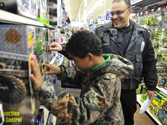 Xavier Maffei, 11, shops with Officer Eric Mumaw during