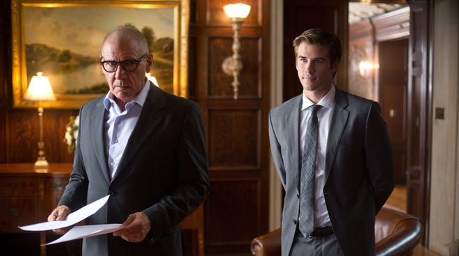 Liam Hemsworth, right, is a regular guy working at a tech firm, and Harrison Ford plays a corporate titan at a rival firm.