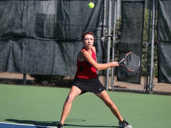 Garden City's Ashlyn Koenning returns a serve during