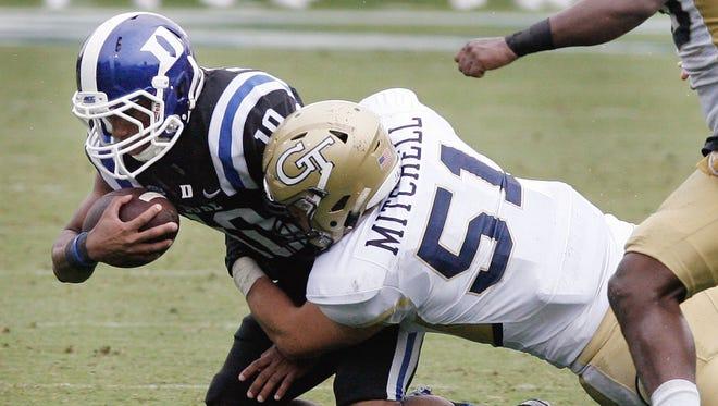 Duke wide receiver Ryan Smith is tackled by Georgia Tech linebacker Brant Mitchell. Duke won 34-20.
