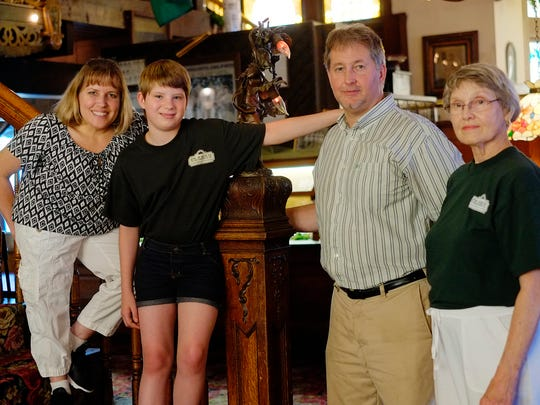 Linda Jubeck, right, with her children co-owners Scott and Cindy and Cindy's daughter Julia, 12, on the staircase inside Clara's restaurant Monday, June 20, 2016.