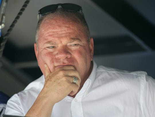 Team owner Chip Ganassi looks on from his pit box during