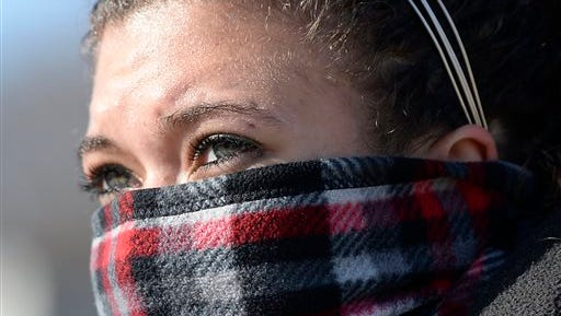 In dangerously cold weather, Angelique Morillo of Kansas City, Kan., was bundled up while she waited Wednesday, Jan. 7, 2015, for a bus at 7th Street and Central Ave., in Kansas City, Kan. (AP Photo/The Kansas City Star, Tammy Ljungblad)