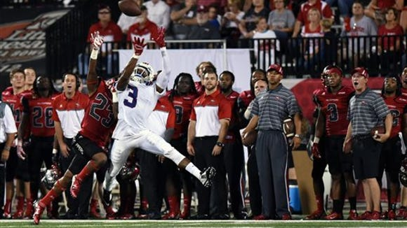 Western Kentucky defensive back De'Andre Simmons (23) and Louisiana Tech wide receiver Paul Turner (3) attempt a catch in the first half of an NCAA college football game Thursday, Sept. 10, 2015, in Bowling Green, Ky. (AP Photo/Michael Noble Jr.)