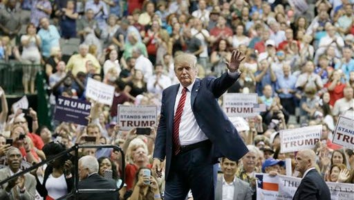 Republican presidential candidate Donald Trump waves to supporters after speaking at a campaign event in Dallas, Monday, Sept. 14, 2015. (AP Photo/LM Otero)