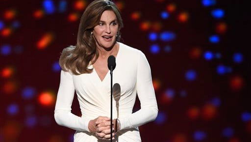 FILE - In this July 15, 2015 file photo, Caitlyn Jenner accepts the Arthur Ashe award for courage at the ESPY Awards at the Microsoft Theater, in Los Angeles. Prosecutors said Wednesday, Sept. 30, they have declined to charge Caitlyn Jenner in the Feb. 7 collision in California in which authorities said Jenner's sport utility vehicle crashed into two cars, pushing one into oncoming traffic.
