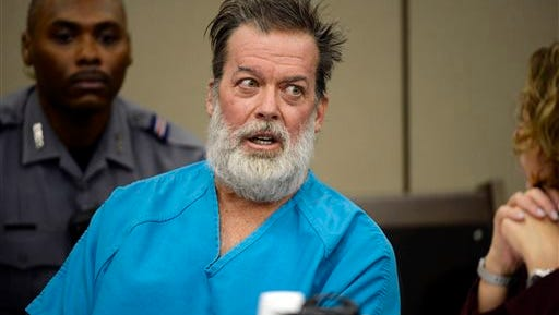 In this Dec. 9, 2015 file photo, Robert Lewis Dear talks during a court appearance in Colorado Springs, Colo. Dear, who admits killing three people and wounding nine others at a Colorado Springs Planned Parenthood clinic on Nov. 27, told KCNC-TV on Wednesday, Jan. 13, 2016 the shooting was spur-of-the-moment.(Andy Cross/The Denver Post via AP, Pool, File)