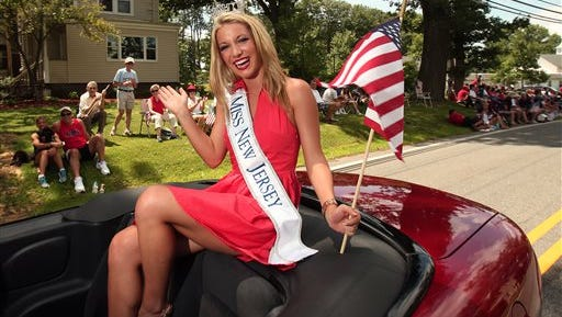 In this July 6, 2013 photo, Miss New Jersey Cara McCollum waves during the annual Randolph Freedom Fest Parade in Randolph, N.J.   McCollum, who was critically injured in a car crash on a New Jersey highway last week, died at Cooper University Hospital early Monday, Feb. 22, 2016. Her family says in a Facebook post that she died with her family by her side in an operating room.