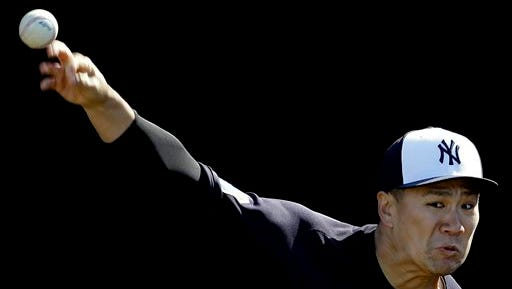 New York Yankees pitcher Masahiro Tanaka throws in the bullpen during a spring training baseball workout Monday, Feb. 22, 2016, in Tampa, Fla. (AP Photo/Chris O'Meara)