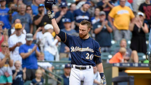 Milwaukee Brewers' Jonathan Lucroy tips his cap after getting a standing ovation from fans while pinch-hitting during the eighth inning of a baseball game against the Pittsburgh Pirates on Sunday, July 31, 2016, in Milwaukee. Lucky stopped a trade to the Cleveland Indians earlier in the day.