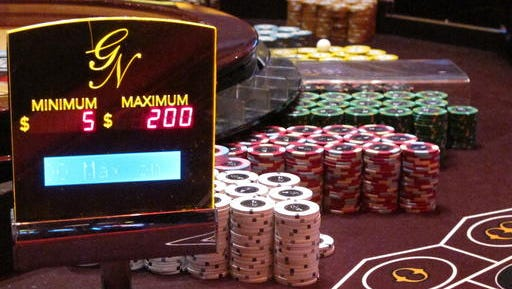 This June 24, 2016 photo shows gambling chips on a roulette table at the Golden Nugget casino in Atlantic City N.J. On Tuesday Nov. 8, 2016, New Jersey voters rejected to allow the expansion of casino gambling beyond Atlantic City to the northern part of the state near New York City.