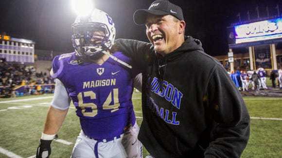 Franklin native coach Mike Houston, right, is the head football coach at James Madison.