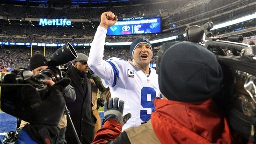 Dallas Cowboys quarterback Tony Romo (9) gestures while leaving the field after an NFL football game against the New York Giants, Sunday, Nov. 24, 2013, in East Rutherford, N.J.