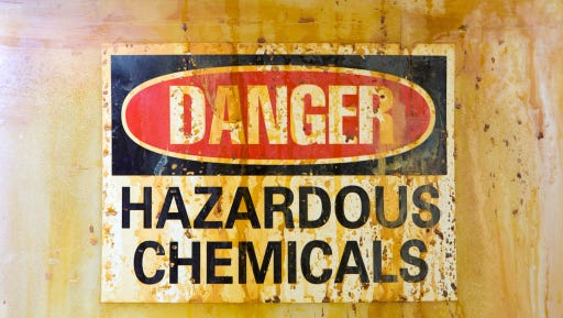 Hazardous chemicals warning sign on a barrel.