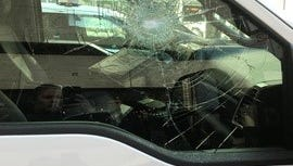 A Cincinnati Fire ambulance was taken out of service after a man threw a rock at the window, police said.