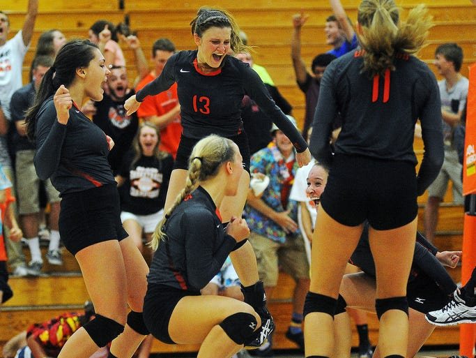Washington's Jamie Kayl (13) reacts with her teammates after the Warriors scored during a match against Roosevelt on Thursday, Sept. 4, 2014, at Washington High School in Sioux Falls, S.D.