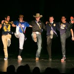 (Left to right) Mr. Stayton High School competitors Toren Ikea-Mario, Ben Diehl, Charlie Weeks, Ryan Forrette and Taren Ikea-Mario open the show with high kicks on Thursday, Feb. 11, 2016. Five students competed for the title, and together raised over $1,000 through ticket sales and donations to give to Stayton Food Bank.