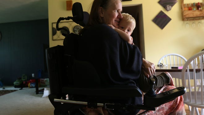 Using her forearms, Laurel Shipton on Friday was able to pick up her grandchild, 14-month-old Oakley, and place him on her lap. Shipton, now living in her daughter Andrea's home in Stratford, Wisconsin, broke her neck Feb. 20, 2016, in a Fond du Lac vehicle crash. She is now paralyzed from her chest to her feet, though she has had some improvement in recent weeks.