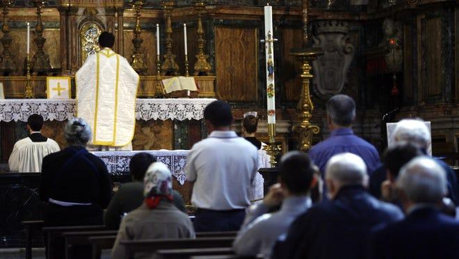 A priest celebrates a Latin Mass in Rome in April 29, 2007.
