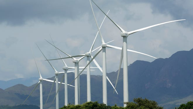 In this photo dated Tuesday, Nov. 10, 2015, wind turbines in Penonome, Panama, as the Central American country seeks to gradually reduce its dependence on fossil fuels.  A U.N.-backed report released Thursday March 24, 2016, says global investments in solar, wind and other sources of renewable energy reached a record $286 billion last year, and the developing world accounted for the majority of investment for the first time.