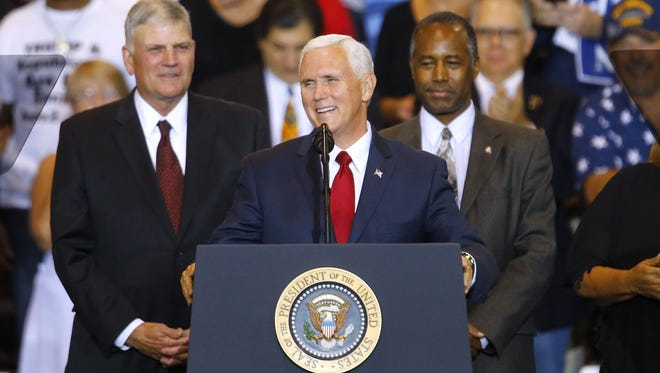 Vice President Mike Pence takes the stage Aug. 22, 2017, in Phoenix.