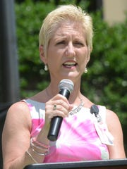 Pam Switzer gives an account of her battle with breast cancer in 2013 at a balloon launch held at the Cleco Corporate Office.