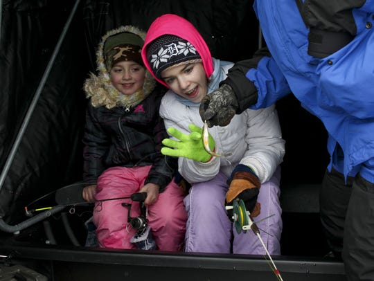 Alyssa Simanovich, 11, of Algonac, reacts as she touches