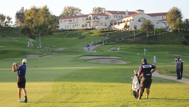 Philip Barbaree Jr. (left) hits his approach to his final hole Tuesday, No. 9 at The Riviera Country Club.