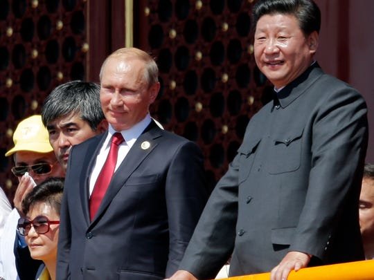 Chinese President Xi Jinping, right, Russian President