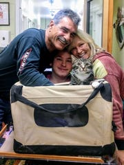 John, Ryan, and Jen Pizzo head home from the shelter with Neo.