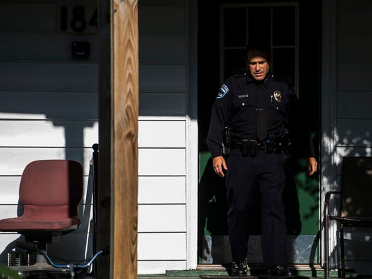 Burlington Police Chief Brandon del Pozo exits an apartment