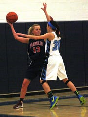 Livonia Franklin's Erin McNally is pressured by Stevenson's