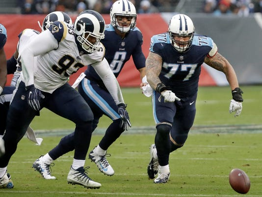 Los Angeles Rams defensive end Ethan Westbrooks (93) and Tennessee Titans tackle Taylor Lewan (77) chase after a fumble in the first half of an NFL football game Sunday, Dec. 24, 2017, in Nashville, Tenn. The Titans recovered the ball. (AP Photo/James Kenney)
