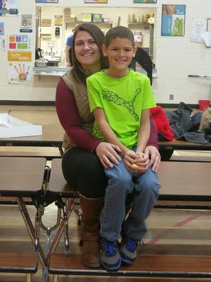 Danika Newberry, a Lakeland student, and Jayden Pragatz, a student at ESAA Elementary, pose after Pragatz raised funds for Newberry upon learning of her serious heart disease diagnosis.