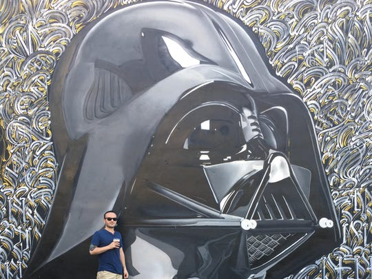 "Wilmington ""Star Wars"" fan and craft beer drinker Sean Jones at the ""Star Wars"" -themed J. Wakefield Brewery in Miami earlier this year. Jones will attend his third consecutive Iron Hill Brewery Dark Side party this weekend."