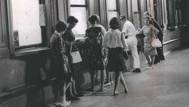 Passengers line up at the ticket office at the Michigan Central Station in July 1966 in Detroit.
