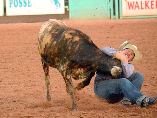 Tyke Kipp of Lordsburg grabs hold of his steer in Friday's Steer Wrestling event at the Eddy County Sheriff's Posse Arena.