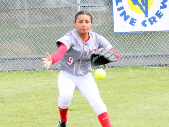 Cobre's Marisa Ray comes up on a ball sharply hit into