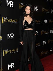 Kendall Jenner wore a velvet bralette as a top on July