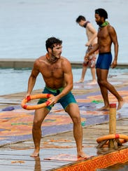 "Michael Yerger competes in a challenge on ""Survivor:"
